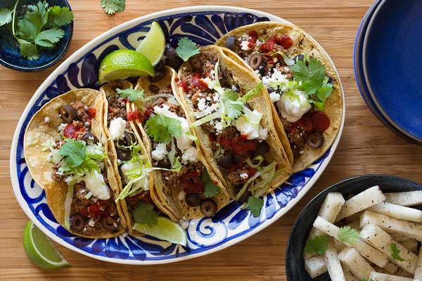 Fully loaded ground beef tacos with jicama sticks